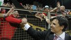 Wales' head coach Chris Coleman celebrates the result with fans.