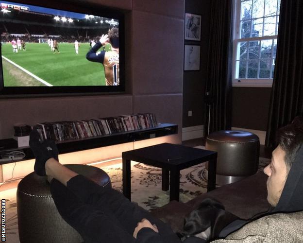 Mesut Ozil in his living room