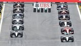 Formula 1 cars line up on the grid