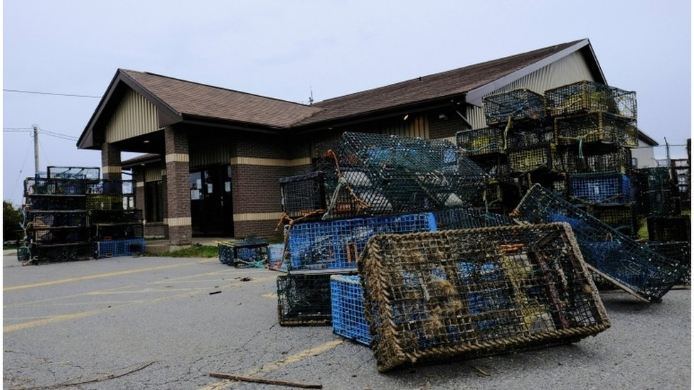 Lobster traps that were seized by non-native fishers lie dumped outside the DFO office
