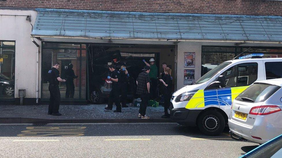 Two hurt as car crashes through Wrexham building