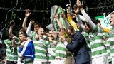 Celtic players celebrating with the Scottish Premirship trophy