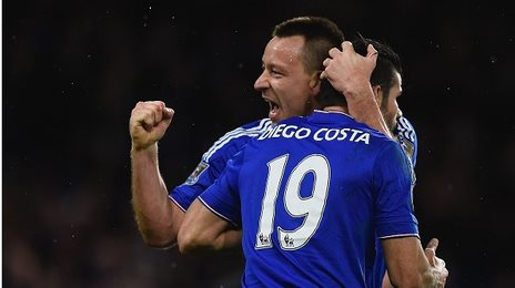 Chelsea forward Diego Costa celebrates his late equaliser against Manchester United with John Terry