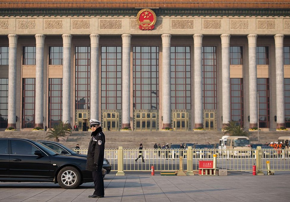 A policeman stands guard outside the Great Hall of the People prior to the unveiling of a new Politburo Standing Committee, in Beijing on 15 November 2012.