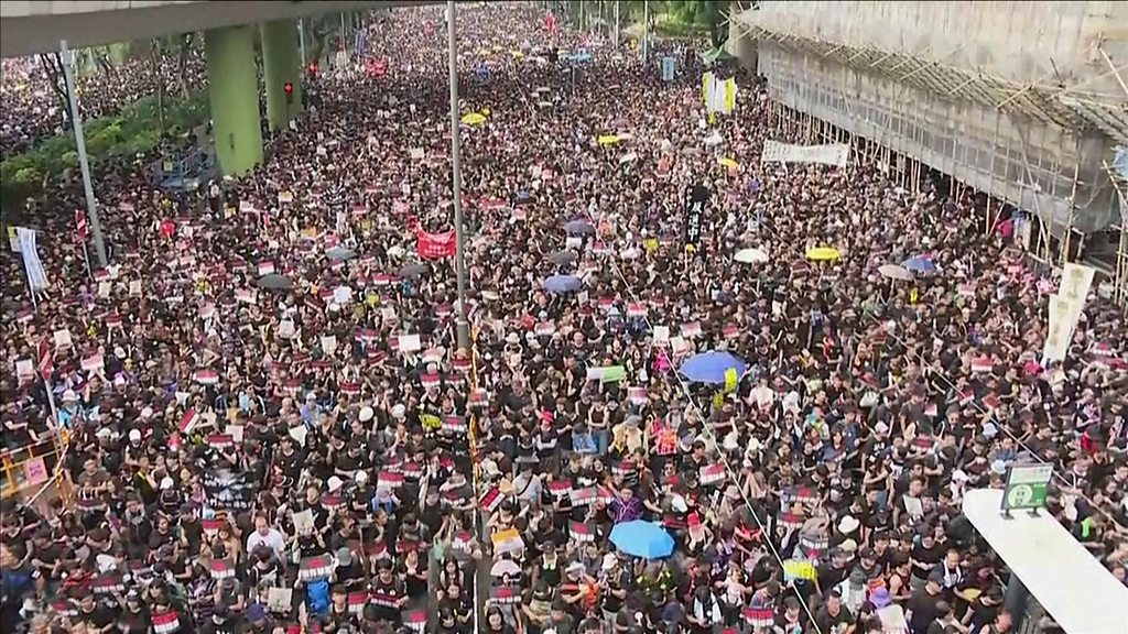 Hong Kong protests: Thousands march against extradition bill
