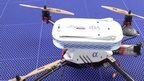 VIDEO: Drone flies over sea to deliver package