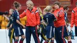 Anna Signeul consoles the Scotland squad after defeat to Sweden