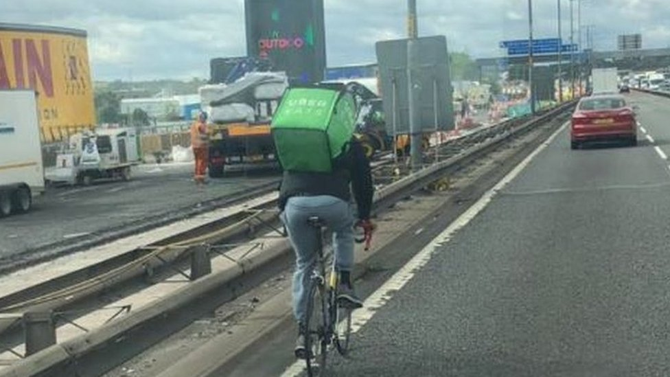 Uber Eats cyclist pictured pedalling on M5 in Oldbury