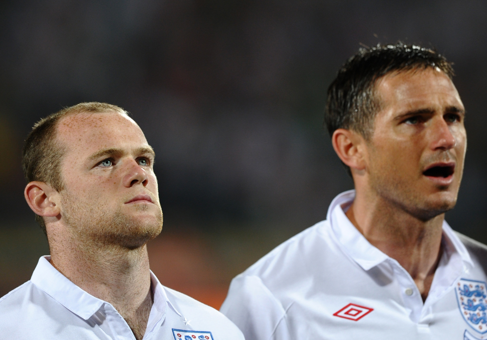 England's striker Wayne Rooney (L) and midfielder Frank Lampard during the national anthem during the 2010 World Cup