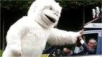 Bernie Ecclestone high-fives a yeti