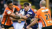 Scott Grix is wrapped up by the Castleford defence