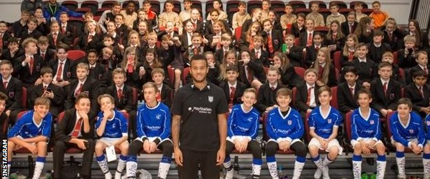 Southampton defender Ryan Bertrand posted this picture on Instagram after visiting a school, saying it reminded him of when he played for his own school growing up