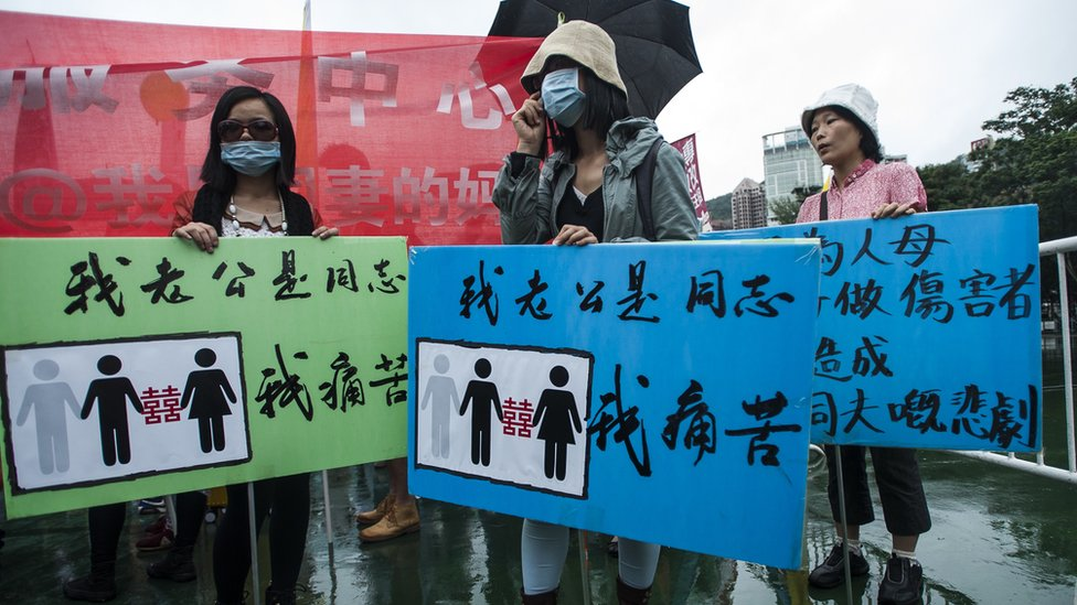 Anti Gay protesters are seen at Victoria Park ahead the Gay Pride Parade in Hong Kong on November 8 2014. The atmosphere was jovial as nearly two thousand people, some wrapped in rainbow-coloured flags and some dressed in drag took to the streets in Hong Kong's Gay Pride parade