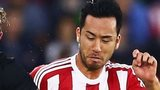 Maya Yoshida battles for the ball