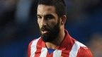 Barca sign Atletico's Turan for £24m