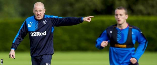Rangers manager Mark Warburton instructs his players in training