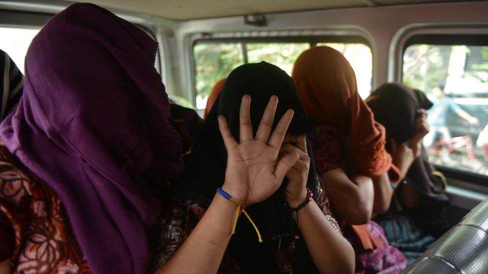 Víctimas de trata durante una operación en Guatemala, en octubre de 2013.