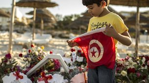 Boy with Tunisian flag on beach in Sousse, 27 June 2015