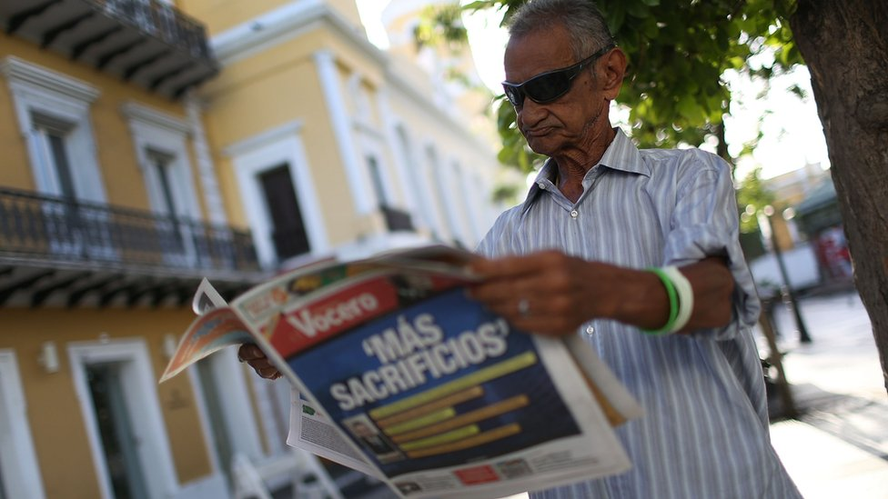 Man reading newspaper in Puerto Rico