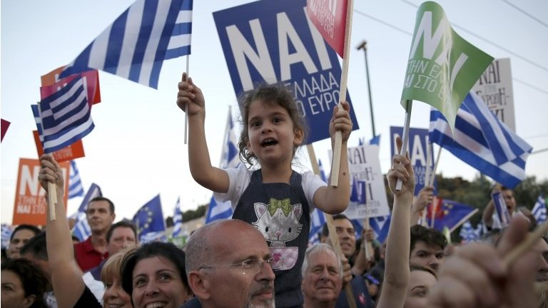 "Greece PM Alexis Tsipras urges voters to reject ""blackmail"" in Sunday's bailout referendum, as thousands gather for rival rallies in central Athens."