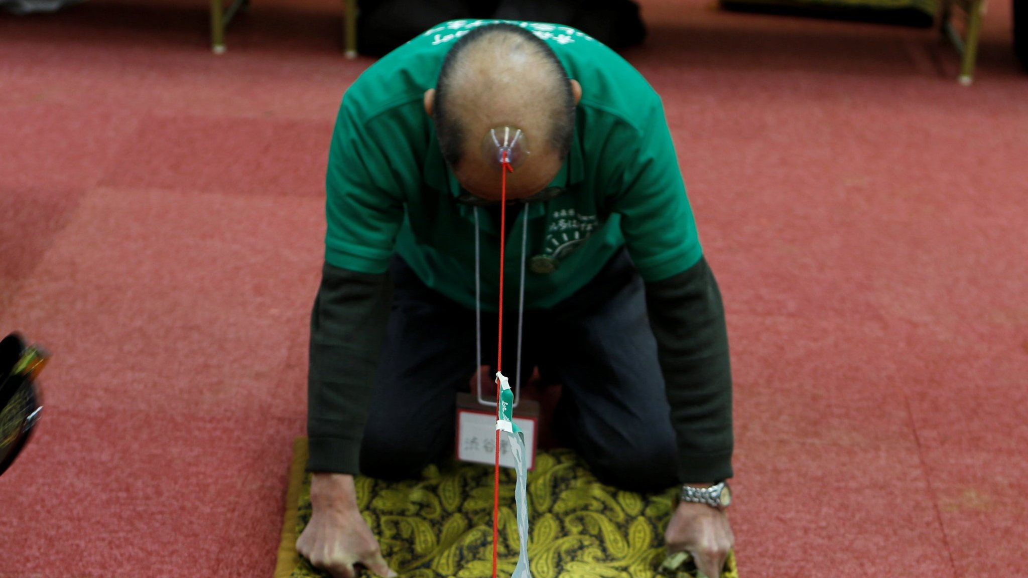 Japanese men celebrate 'baldy' pull factor
