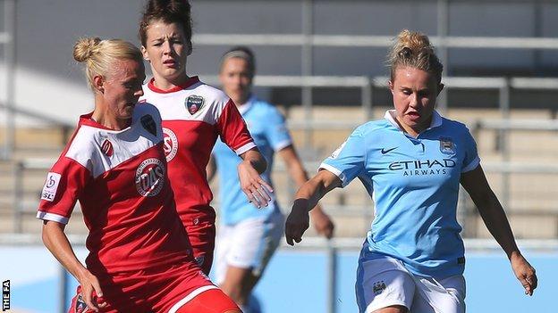 Bristol's Sophie Ingles challenges Manchester City's Isobel Christiansen (right)