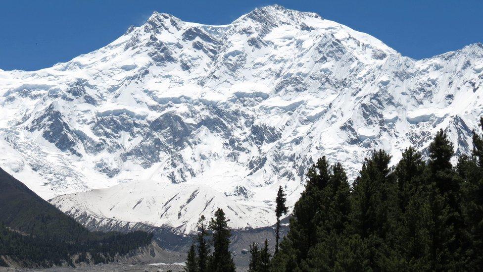 A tourist enjoys the view of Nanga Parbat, Pakistan's second-highest mountain.