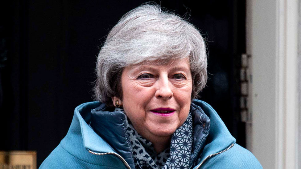 May sticks to Brexit strategy amid Tory row