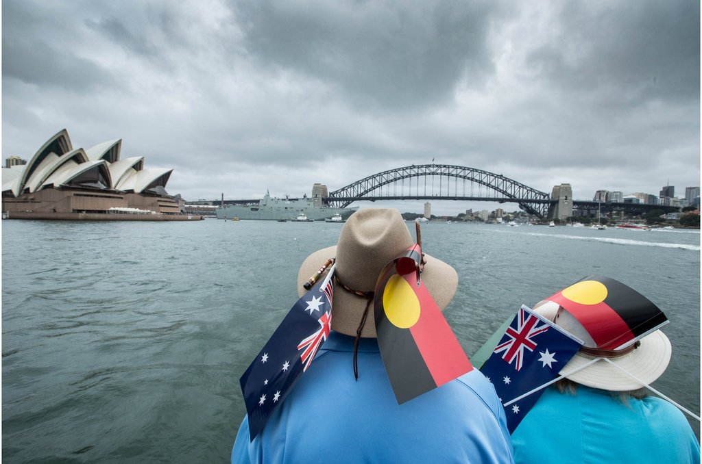 Participants wearing Australian and Aboriginal flags are seen aboard the ferry Emerald 6 during the annual Australia Day Ferrython on Sydney Harbour, Sydney, New South Wales, Australia, 26 January 2018. Australia Day is celebrated annually on 26 January to mark the arrival of the first British convict fleet in 1788. EPA/GLENN CAMPBELL AUSTRALIA AND NEW ZEALAND OUT