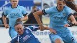 Birmingham City's Remi Allen wins the ball ahead of Manchester City's Jill Scott