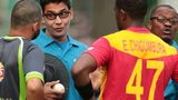 Umpire Ruchira Palliyaguruge talks to Pakistan and Zimbabwe players after suspending play because of bad light
