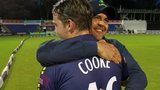 Chris Cooke is hugged by Glamorgan captain Jacques Rudolph