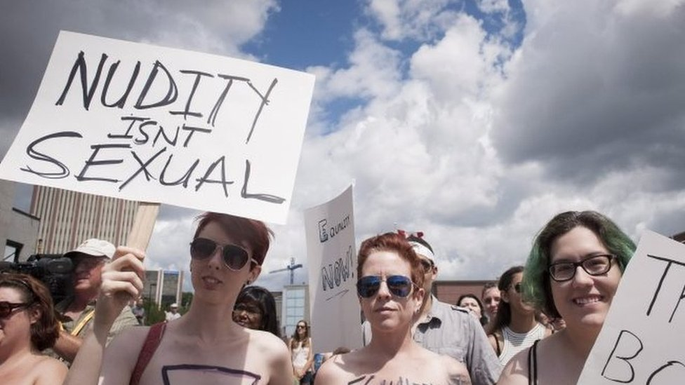 Hundreds of Canadian woman join a topless protest march after three sisters were allegedly stopped by police for cycling without shirts.