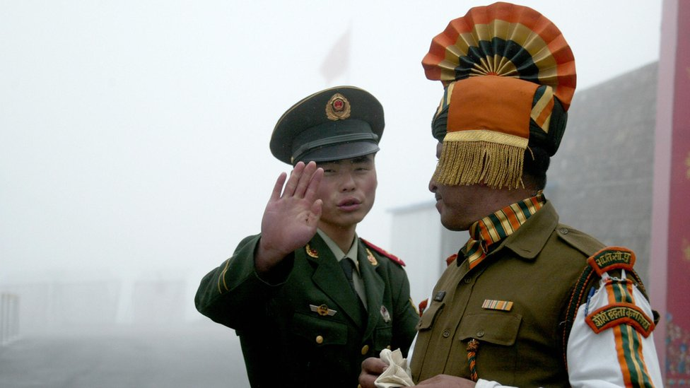 File photo of an Indian and Chinese soldier on the border