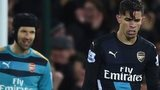 Petr Cech and Gabriel look dejected after Norwich's goal