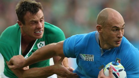 Ireland winger Tommy Bowe challenges Italy's Sergio Parisse