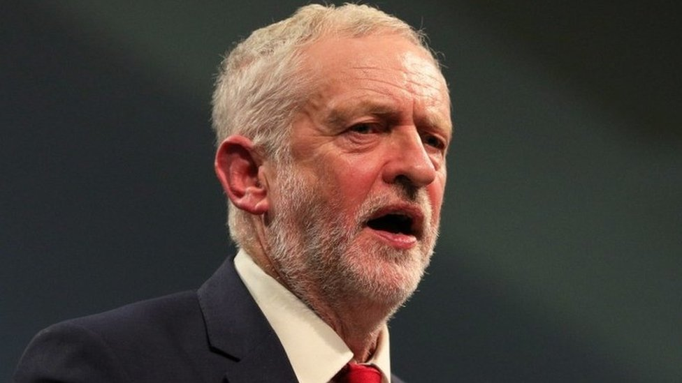 Jeremy Corbyn should be 'open' over spy's claims, says Theresa May