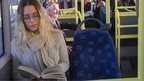 Woman reading on bus