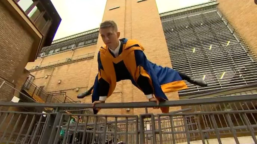 Max Whitlock: Olympic gymnast in a degree celebration pose