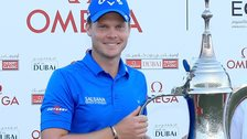 English golfer Danny Willett celebrates winning the Omega Dubai Desert Classic