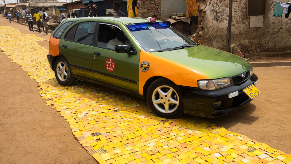 In pictures: Follow Ghana's 'yellow-brick road'