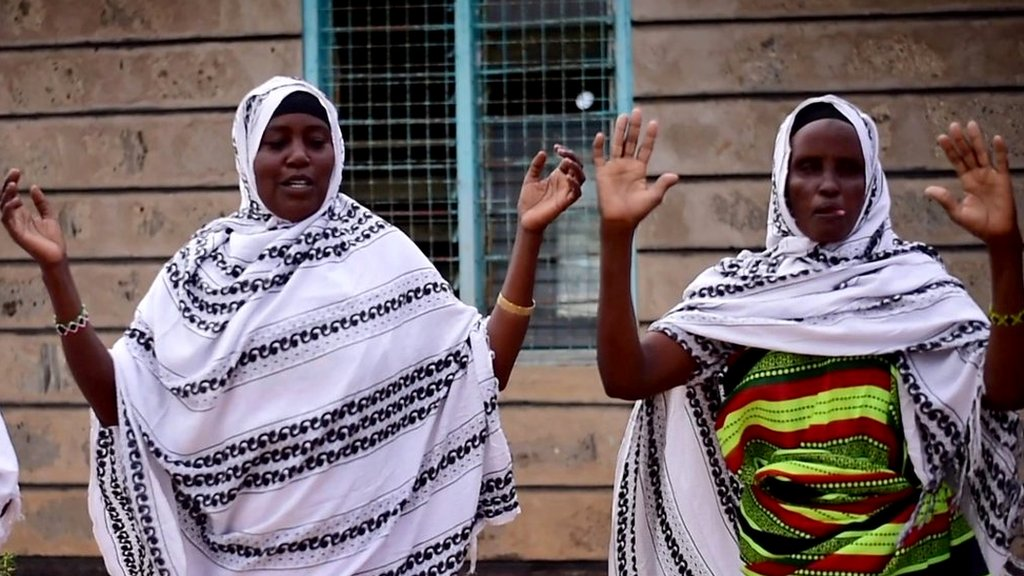 Kenyan villagers dance the 'waley' to praise their cows