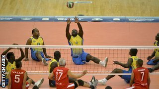 men playing sitting volleyball