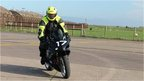 Adrian Chiles rides an electric bike
