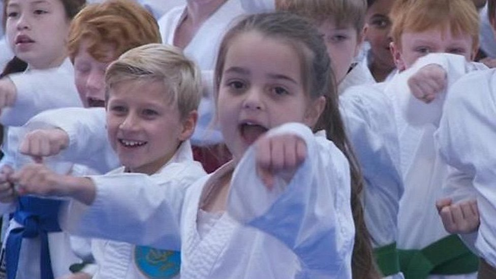 Eight-year-old Arena attack survivor goes back to karate