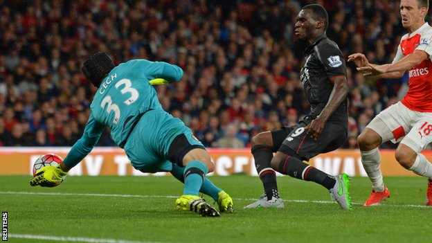 Arsenal keeper Petr Cech saves from Liverpool striker Christian Benteke
