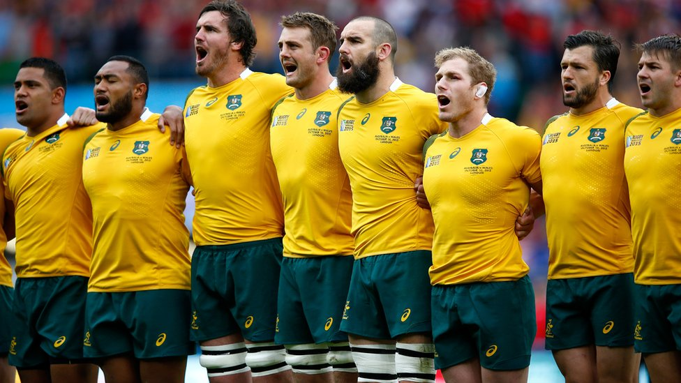 Australia players clasp shoulders and sing national anthem at Twickenham stadium