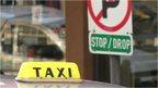 Taxi sign and stop/drop street sign