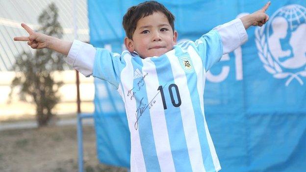 Murtaza and his signed Messi shirt