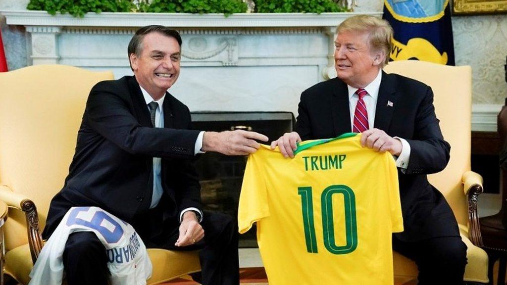 Jair Bolsonaro and Donald Trump swap football shirts